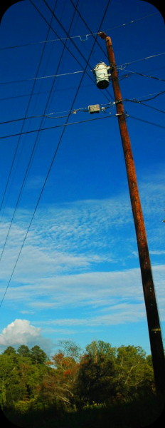 power lines cutting through a blue sky